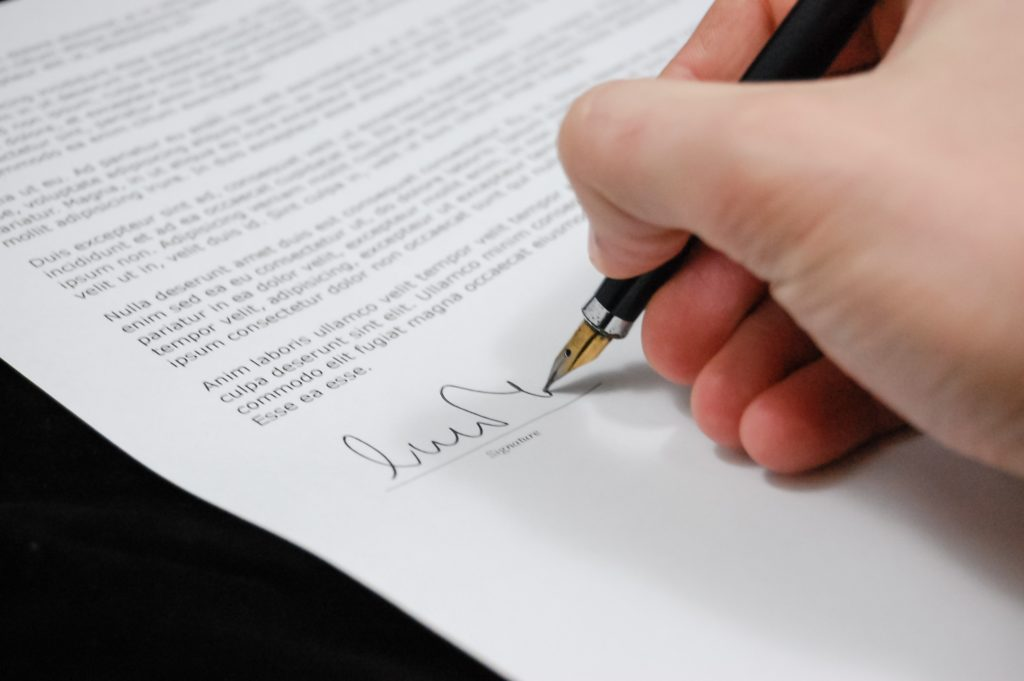 Florida medical marijuana Document being signed by hand holding a pen